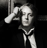 James McCartney backs Willie Nelson, Bob Dylan and Billy Joel as they sing his father's songs.