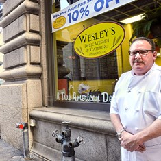 20140909lrwesleydelibiz02-1 Wesley Ross at his renamed deli on Fourth Avenue, Downtown.