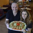 Samir and Rawah Moussa with falafel in their restaurant Palmyra at 10 Smithfield Street.