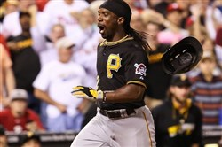 Pirates center fielder Andrew McCutchen  reacts as he crosses home plate after hitting an inside the park home run during the fifth inning against the Phillies at Citizens Bank Park.