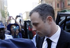 Oscar Pistorius arrives at the high court in Pretoria, South Africa, on Thursday. A judge today found him guilty of culpable homicide.