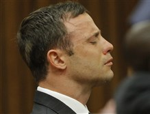 Oscar Pistorius reacts in the dock in Pretoria, South Africa, today as Judge Thokozile Masipa says that prosecutors have not proved beyond a reasonable doubt that the double-amputee Olympic athlete is guilty of premeditated murder.
