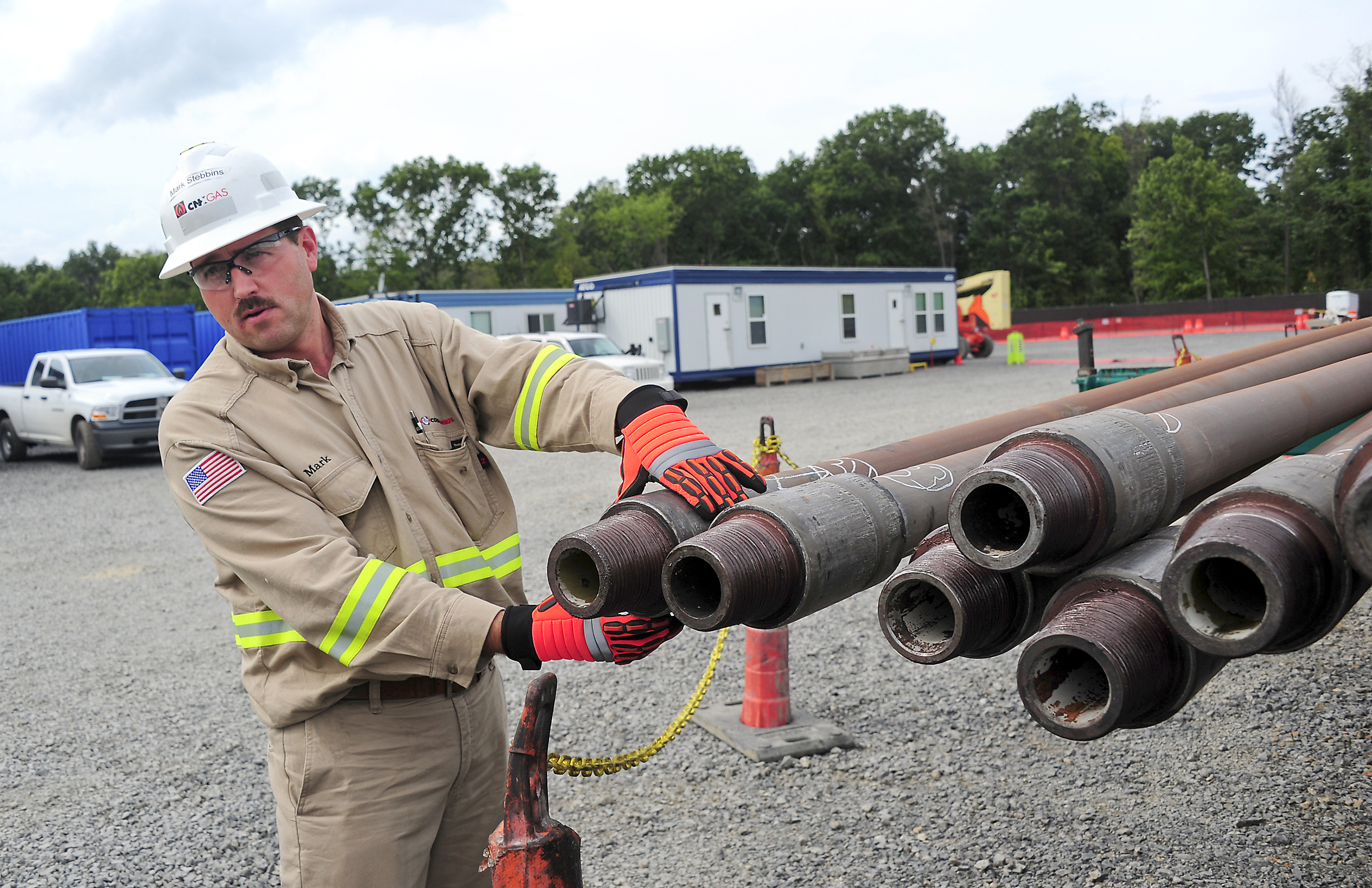 Mark Stebbins, District Operations Superintendent, Gas. of Consol Energy Inc.cups a 4.5 inch steel pipe, one of dozens needed to drill a shale well. Each rod weights 750 pounds and is reused in the drilling of other wells.
