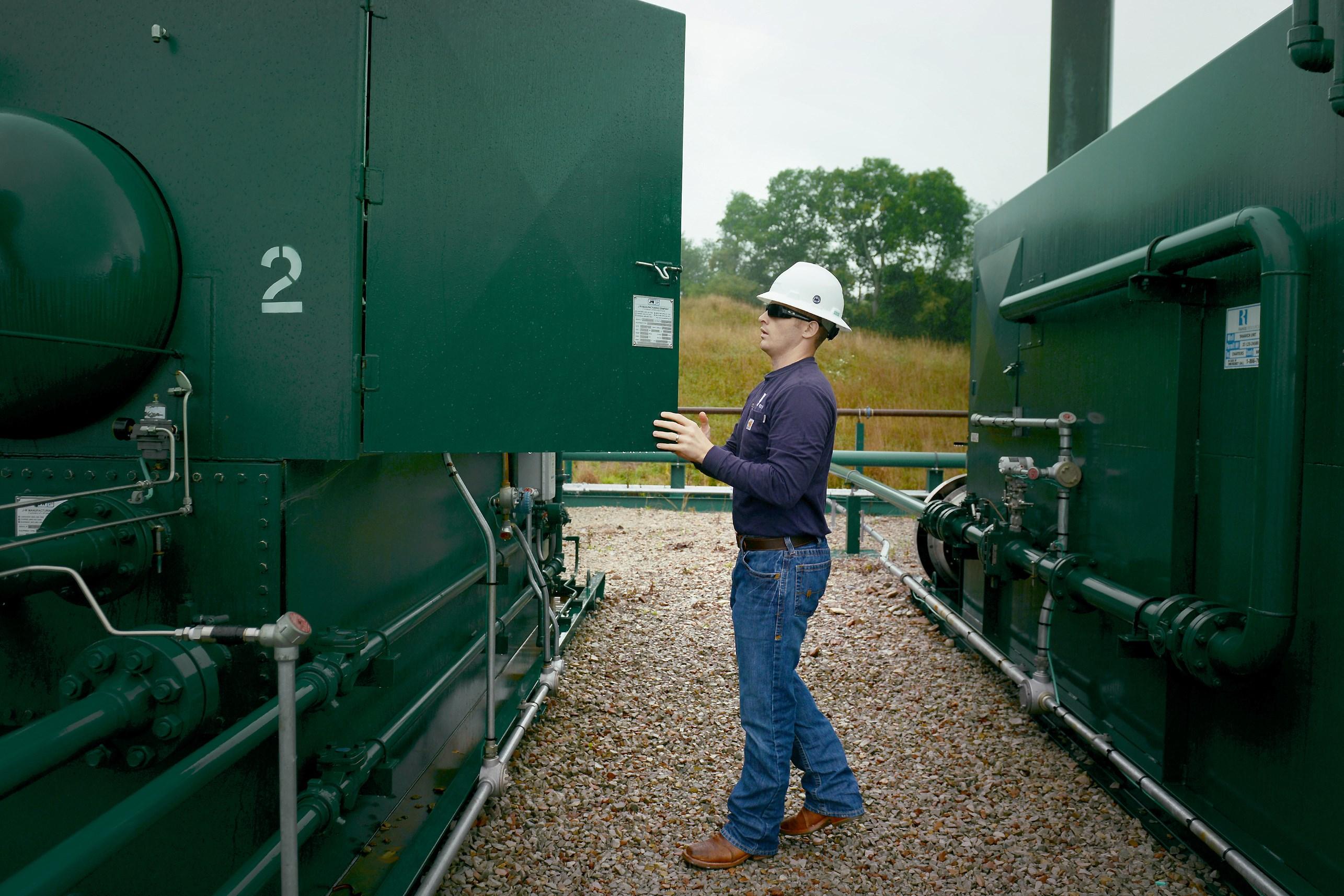 Air force veteran Sean Rooney checks equipment for Range Resources in Washington County.