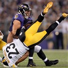 The Steelers' Mike Mitchell dives to try to stop the Ravens' Owen Daniels in the third quarter of Thursday's loss in Baltimore.