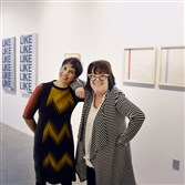 Joy Borelli-Edwards,left, owner of Borelli-Edwards Galleries in Lawrenceville,  with curator Vicky A. Clark in the new 500-square foot gallery.