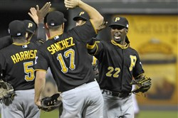 Pirates center fielder Andrew McCutchen and teammates celebrate the 4-1 win against the Philadelphia Phillies.