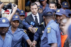 Oscar Pistorius leaves the High Court in Pretoria on Friday after the verdict in his murder trial where he was found guilty of culpable homicide.  AFP PHOTO/GIANLUIGI GUERCIAGIANLUIGI GUERCIA/AFP/Getty Images