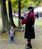 A piper and child at the Penn's Colony Festival in Saxonburg.