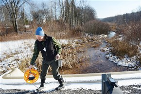 DEP inspector John Sengle prepares to take water samples from Hawk Run near Philipsburg.