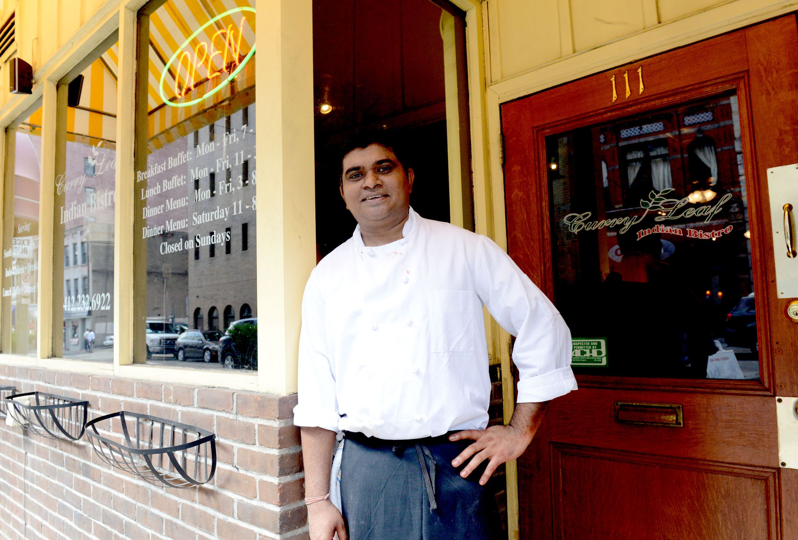 20140911ppTable0918WKNDMAG2-1 Prassana Kumar, owner & chef of Curry Leaf Indian Bistro, is among the ethnic restaurants on Smithfield Street, Downtown.