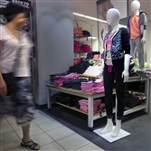 A woman passes an active wear display last month at a J.C. Penney store. The Commerce Department said Friday that seasonally adjusted retail sales rose 0.6 percent compared with the prior month.