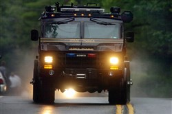 A Pennsylvania State Police vehicle speeds along Route 402 on Saturday near the scene where a Pennsylvania State Trooper was killed and another trooper was injured during a shooting late Friday night at the state police barracks in Blooming Grove.