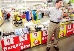 Joe Kallen, CEO of home improvement store Busy Beaver, points out the bargain bins situated in the center aisle of the New Kensington location during a tour discussing the stores' reorganization.