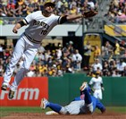 Pirates' Jordy Mercer tries to pull in the ball on a steal attempt by Cubs' Javier Baez in the third inning at PNC Park today. PIrates won, 7-3.
