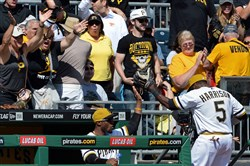 Pirates fans cheer as Josh Harrison leaves the field after the team completed a triple play against the Cubs in the fourth inning Sunday at PNC Park.