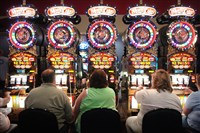 Patrons play slot machines at the Meadows Racetrack and Casino in Washington County. Bills, such as one proposed on Internet gambling and off-track horse racing betting parlors by Sen. Kim Ward, R-Westmoreland, are being considered as lawmakers look to use gambling monies as revenue to reduce the state's budget deficit.