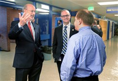 Democratic candidate for governor Tom Wolf, left, talks with Greg Taranto, center, principal at Canonsburg Middle School, and seventh-grade social studies teacher Robert Stone.