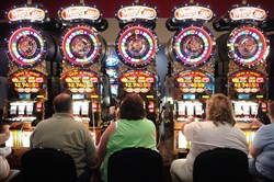 Gamblers at the slots at The Meadows Racetrack and Casino.