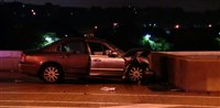 A woman was killed overnight when she crashed into the wall of an off-ramp on the Birmingham Bridge.