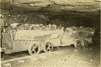 "Coal wagon (1907): The Vesta Coal Company, a subsidiary of Jones & Laughlin Steel Corporation, employed various types of rolling equipment in their mines. A coal car known as a ""wagon"" was used to haul raw coal from the mines to the coal breaker. These cars also transported rock from the tunnels below to the surface. Some company mine cars were equipped with side hand brakes. The brakes were always on one side of the car and were applied easily by depressing the brake handle. The Vesta No. 4 Mine, once the largest bituminous coal mine in the world, contained over 100 miles of track. Each trip of loaded cars arriving at the tipple contained approximately 500 tons of coal. Transportation of the cars was handled by an elaborate system of tracks within the mine. All trips throughout the mine were controlled by an automatic signal system similar in design to the contemporary railroads of that time. A dispatcher was present day and night to dispatch the empty and loaded trips into and out of the mine."