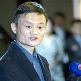 Alibaba Group founder and executive chairman Jack Ma speaks to reporters before an IPO road show at a hotel in Hong Kong on Monday.