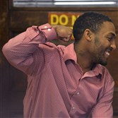 Leon Ford pumps his fist in celebration as he talks with his father outside the third-floor courtroom in the Allegheny County Courthouse in September.