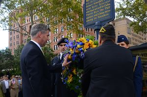 University of Pittsburgh chancellor Patrick Gallagher, left, lays a hand on a flower wreath presented in the celebration of 100th year of the formation of the Veterans of Foreign Wars of the United States at William Pitt Union in Oakland.