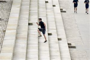 Joe Hultzen of the North Side runs the stepped wall along the Allegheny River side of the Point State Park.