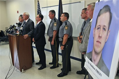 Pennsylvania State Police Commissioner Frank Noonan speaks today at a news conference in Blooming Grove. Commissioner Noonan identified Eric Matthew Frein, 31, as the gunman who killed one trooper and injured another in a late-night ambush outside a state police barracks.