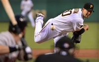 Pirates' Charlie Morton delivers against the Red Sox at PNC  Park .