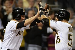 The Pirates' Russell Martin is greeted at home by Neil Walker after hitting a two-run blast against the Red Sox Tuesday at PNC Park.