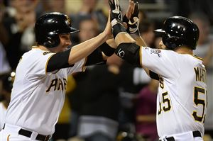 The Pirates' Russell Martin is greeted at home by Neil Walker after hitting a two-run homer against the Red Sox.