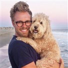 "Photographer Seth Casteel, author of ""Underwater Puppies,"" with his own poodle mix Nala."
