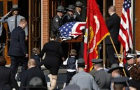 Family members follow as an honor guard carries the casket of Pennsylvania State Trooper Cpl. Bryon Dickson into St. Peter's Cathedral in Scranton.