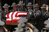 An honor guard carries the casket of Pennsylvania State Trooper Cpl. Bryon Dickson from St. Peter's Cathedral Thursday in Scranton.
