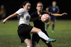 Serra Catholic defender Clara Almeter, left, and South Allegheny midfielder Haley Wackowski fight for possession on a throw-in Wednesday. Serra Catholic won, 3-2.