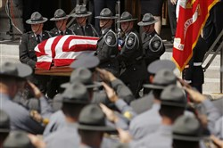 An honor guard carries the casket of Pennsylvania State Trooper Cpl. Bryon Dickson on Thursday in Scranton.