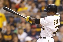 Gregory Polanco hits a solo home run in the first inning of a game against the Boston Red Sox, Wednesday, Sept. 17, 2014, in Pittsburgh.