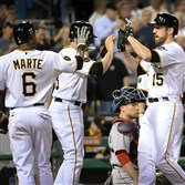 Ike Davis celebrates with teammates his three-run home run against the Red Sox at PNC Park.