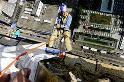 Dennis Unkovic rappels over the edge of the 25-story Henry W Oliver Building in Downtown Pittsburgh on Wednesday, Sept. 17, 2014.