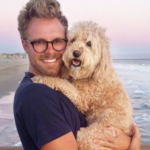 """Photographer Seth Casteel, author of """"Underwater Puppies,"""" with his own poodle mix Nala."""