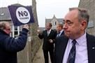 Scotland's First Minister Alex Salmond, looks on at a No campaigner Thursday during a walkabout in Ellon, Scotland.