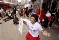 "Julia Johnson, of the South Side Slopes, dances to the music wearing an ""I Am August"" T-shirt at the Artists 4 August Wilson rally to celebrate the fifth anniversary of the opening of the August Wilson Center."