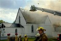 Firefighters try to extinguish the blaze at St. Paul Baptist Church in Oakmont on Friday.