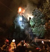 Pittsburgh firefighters battle a three-alarm fire at two houses in South Oakland early this morning.