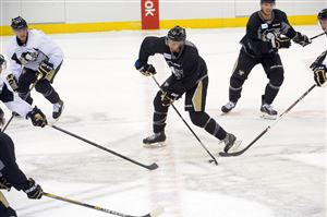 Nick Spaling shoots the puck in the Penguins training camp at Consol Energy Center.