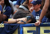 Leah McCormick, 19, a sophomore at Pitt from Toledo, Ohio, hangs her head as Pitt loses to Iowa Saturday at Heinz Field.