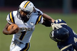 Apollo-Ridge's Tre Tipton gets by Shady Side Academy's Eric Yoest Friday night at Michael J. Farrell Stadium.