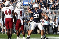 Penn State Nittany Lions running back Zach Zwinak reacts after scoring a touchdown during the second quarter against the Massachusetts Minutemen at Beaver Stadium.